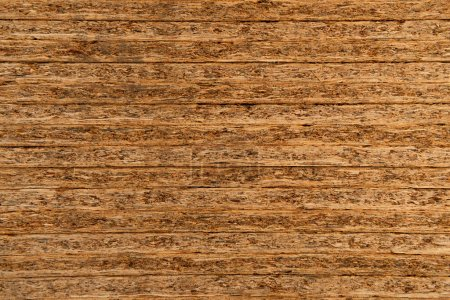 background of natural, stacked pressed wood sheets