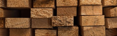 Photo for Background of natural, stacked hardwood boards, banner - Royalty Free Image
