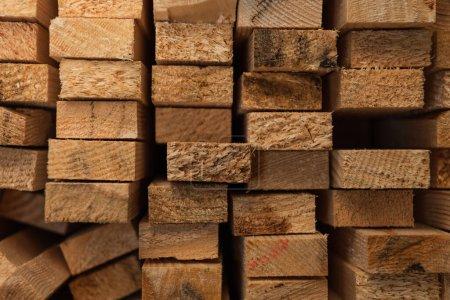 background of stacked, natural hardwood planks