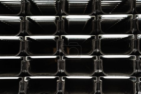 Photo for Black background with metallic construction elements, top view - Royalty Free Image