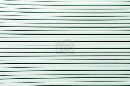 background of white horizontal rows of plastic elements, top view