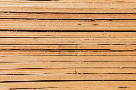 stacked plywood sheets textured background