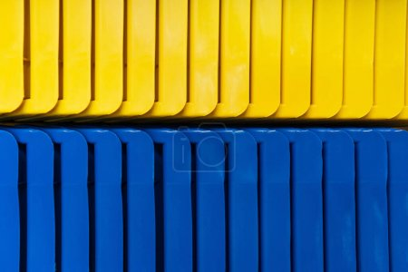 background of yellow and blue plastic elements, top view