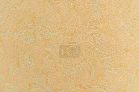 couleur pastel, fond texturé, avec motif abstrait en relief, vue du dessus