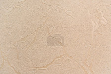 pastel pink, textured wallpaper, with embossed abstract pattern, top view