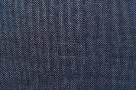 background of dark blue, textured surface, with sackcloth imitation, top view