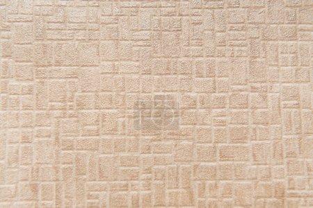 Photo pour Papier peint beige avec motif géométrique en relief, vue de dessus - image libre de droit