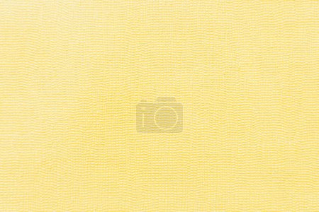 yellow wallpaper with textured surface, top view