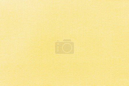 Photo pour Papier peint jaune avec surface texturée, vue de dessus - image libre de droit