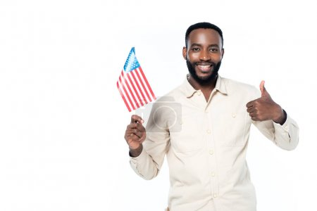 happy american man holding small flag of usa while showing thumb up isolated on white