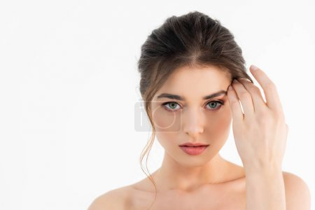 Photo for Charming woman with naked shoulders looking at camera isolated on white - Royalty Free Image