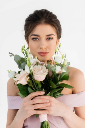 young woman with wedding bouquet looking at camera isolated on white