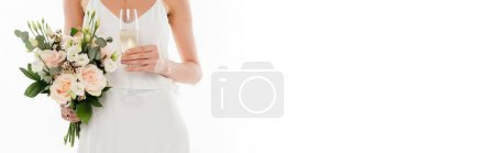 partial view of fiancee holding champagne glass and wedding bouquet isolated on white, banner
