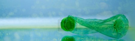used, crumpled plastic bottle underwater, ecology concept, banner