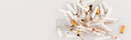 Photo for Top view of cigarette ends on white surface, ecology concept, banner - Royalty Free Image