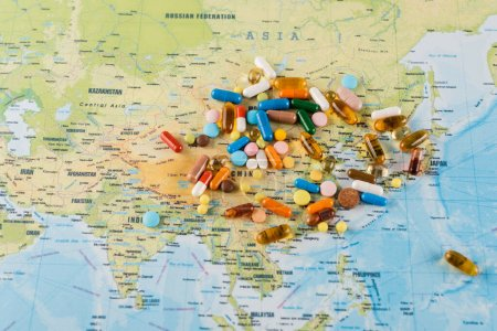 pile of medicines on map, ecology concept