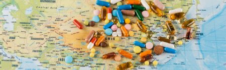 top view of plenty of pills on map, ecology concept, banner