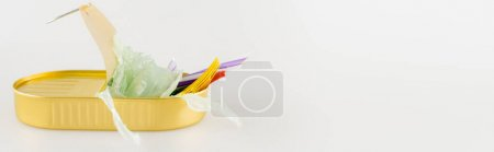 tin with plastic rubbish on white background, ecology concept, banner