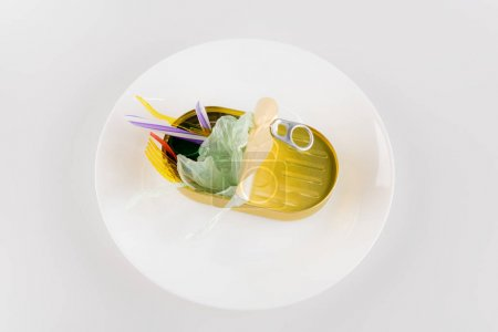 Photo for Top view of plate with plastic trash on white, ecology concept - Royalty Free Image