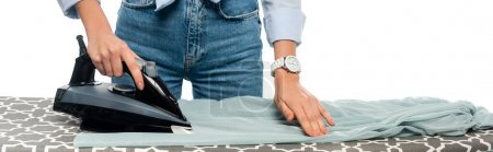 cropped view of woman in jeans ironing clothes isolated on white, banner