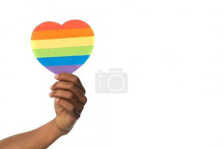 hand of african american holding rainbow colors paper heart isolated on white