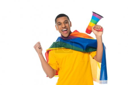 Photo for Excited african american man with lgbt flag and megaphone in rainbow colors showing win gesture isolated on white - Royalty Free Image