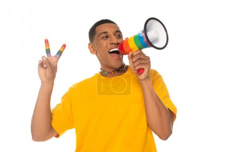 african american transgender man screaming in megaphone while showing peace sign isolated on white
