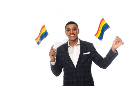 happy african american businessman with makeup holding lgbt flags isolated on white