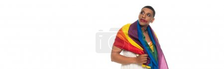 african american transsexual man, covered with lgbt flag, looking way isolated on white, banner