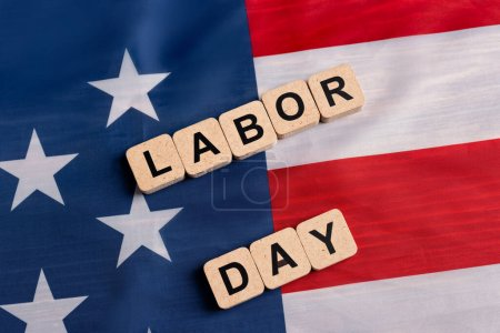 top view of wooden cubes with labor day lettering on usa flag