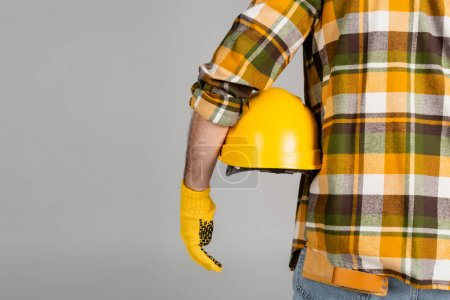 Photo for Back view of builder with hardhat isolated on grey, labor day concept - Royalty Free Image