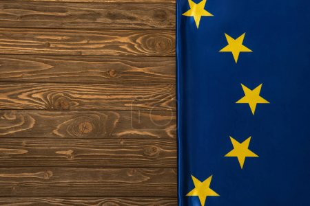 top view of european union flag on wooden surface