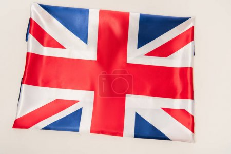 top view of national flag of united kingdom with red cross isolated on white