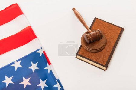 Photo for Top view of american flag near books and gavel isolated on white - Royalty Free Image
