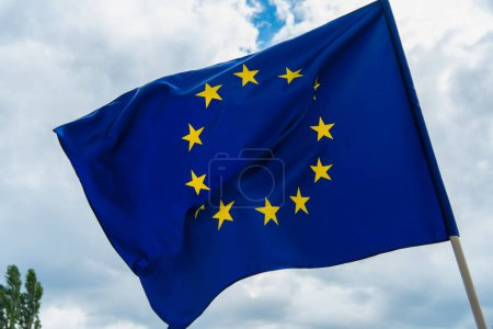 low angle view of european union flag with yellow stars against sky