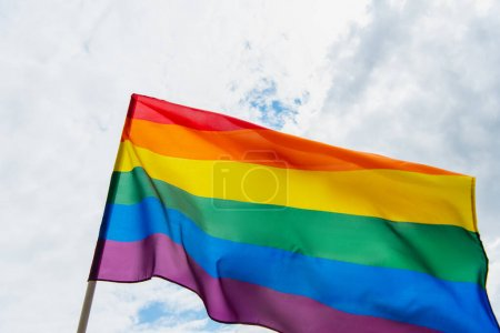 Photo for Low angle view of colorful lgbt flag against sky with clouds - Royalty Free Image