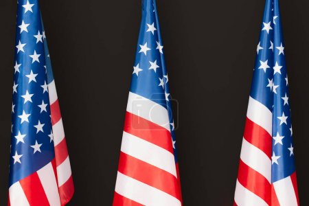 red and blue american flags with stars and stripes isolated on black