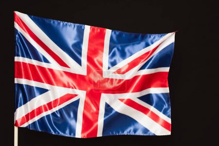 national flag of united kingdom with red cross isolated on black