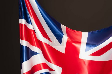 flag of united kingdom with red cross isolated on black