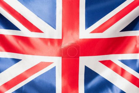 close up of british flag of united kingdom with red cross