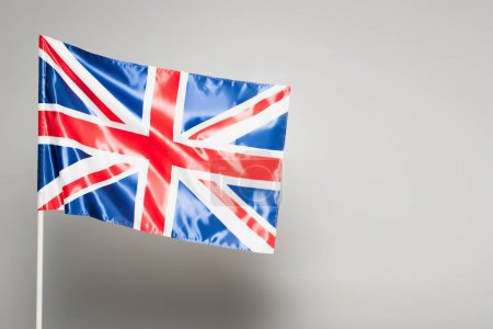 British flag of united kingdom with red cross on grey