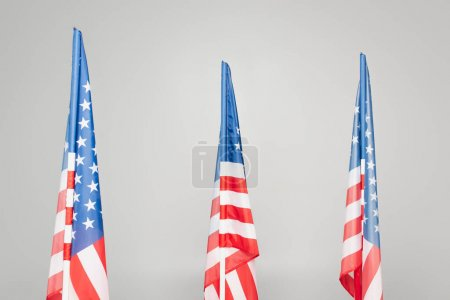 red and blue flags of usa with stars and stripes isolated on grey