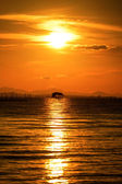 The old wooden pavilion, on the Black Lake. With sunset sky, tha