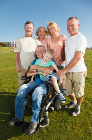Disabled Man with family outside.