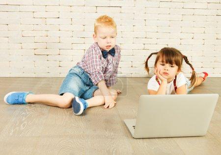 Preschoolers with laptop