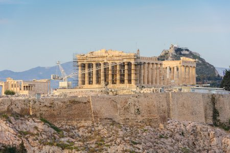 Photo for Ancient Acropolis in rays of sunset. Athens Greece. Copyspace. - Royalty Free Image