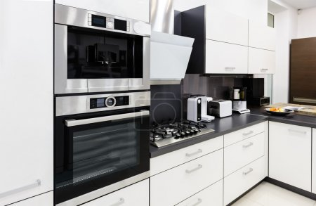 Photo for Modern luxury hi-tek black and white kitchen interior, clean design - Royalty Free Image