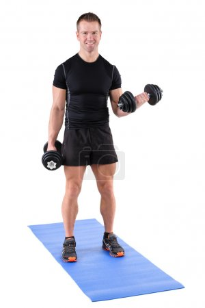 Young man shows finishing position of biceps curl