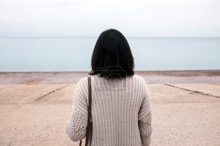 Photo for Woman looking at the sea - Royalty Free Image