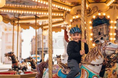Littel boy on carousel ride